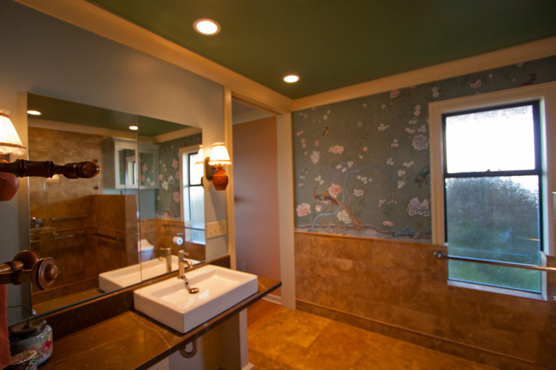 Master bathroom with full height pocket door
