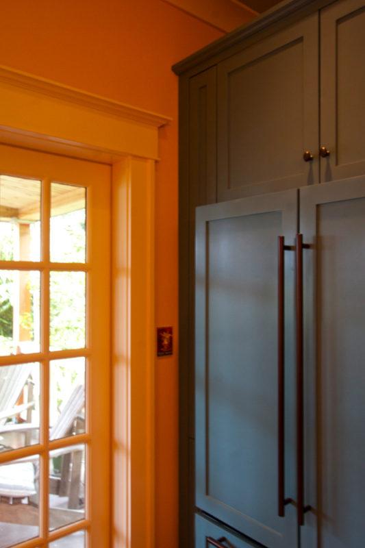 Painted refrigerator custom wood panels & hardware.