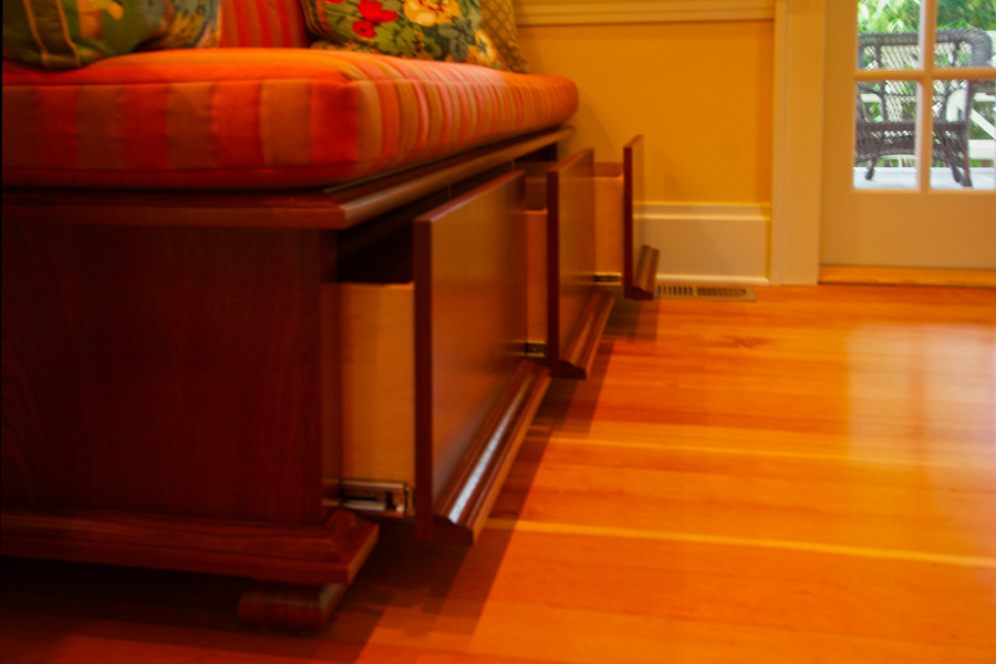Deep drawers in custom mahogany built-in bench.