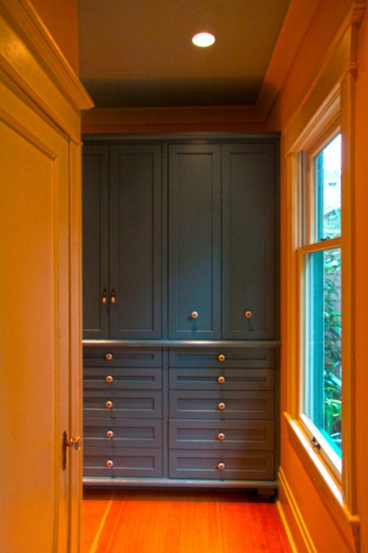 Painted vintage blue pantry & microwave storage.