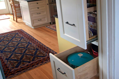 A Pullout Pantry Cabinet that uses unused space behind cabinet.