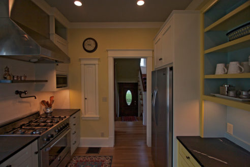 Stove, back-splash, pot fill and custom cabinetry.