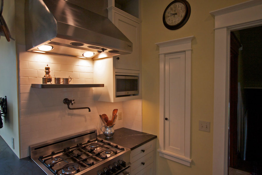 Stove with classic pot fill and handmade ceramic back-splash.