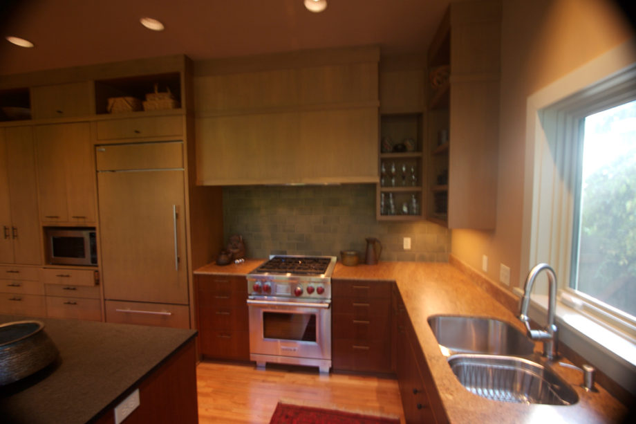 Wide View of Kitchen Area Featuring Sink & Stove